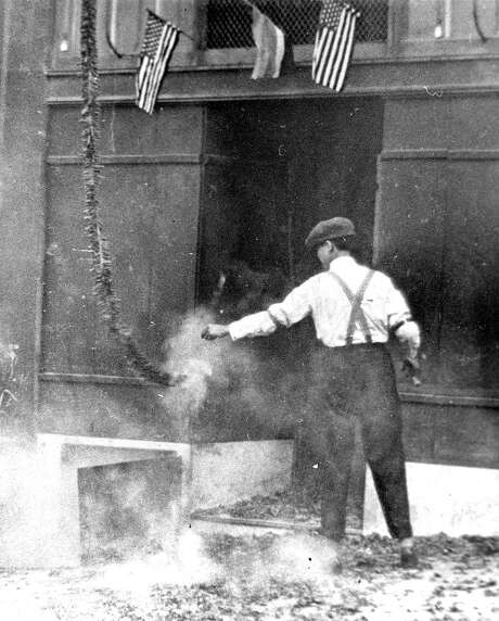 Firecrackers set off in Chinatown 1938 photo by L.J. Stellman Courtesy of The Society of California Pioneers