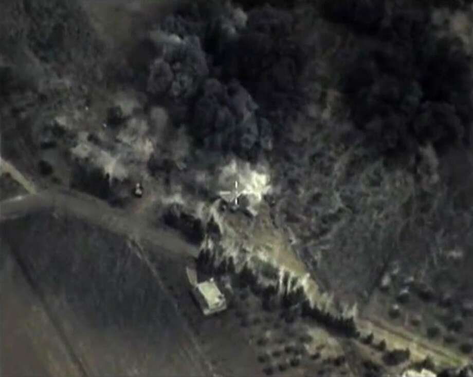 "A video grab made on September 30, 2015, shows an image taken footage made available on the Russian Defence Ministry's official website, purporting to show an airstrike in Syria.  Russia launched air strikes in war-torn Syria, its first military engagement outside the former Soviet Union since the occupation of Afghanistan in 1979.  Russian warplanes carried out strikes in three Syrian provinces along with regime aircraft as Putin seeks to steal US President Barack Obama's thunder by pushing a rival plan to defeat Islamic State militants in Syria.  AFP PHOTO / RUSSIAN DEFENCE MINISTRY   RESTRICTED TO EDITORIAL USE - MANDATORY CREDIT  "" AFP PHOTO / Russian Defence Ministry""  -  NO MARKETING NO ADVERTISING CAMPAIGNS   -   DISTRIBUTED AS A SERVICE TO CLIENTS -/AFP/Getty Images Photo: -, Handout / AFP / Getty Images / AFP"