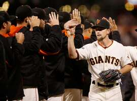 SAN FRANCISCO, CA - SEPTEMBER 30:  Mike Leake #13 of the San Francisco Giants is congratulated by teammates after they beat the Los Angeles Dodgers at AT&T Park on September 30, 2015 in San Francisco, California.  (Photo by Ezra Shaw/Getty Images)