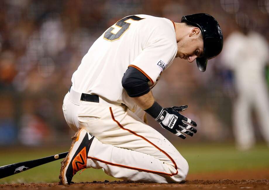 Matt Duffy kneels on the ground after almost being hit by a pitch at AT&T Park on September 30, 2015. Photo: Ezra Shaw, Getty Images