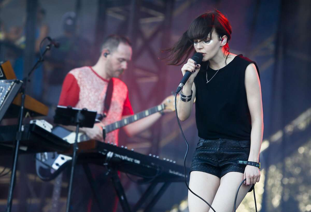 Chvrches' Lauren Mayberry, right, and Iain Cook perform on the first day of the Austin City Limits Music Festival on Friday, Oct. 3, 2014, in Austin, Texas.