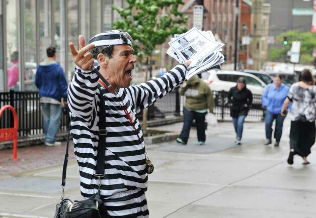 Member of the Prison Blues Brothers,  Randy Credico, dressed in prison stripes, stages a protest outside the State Comptroller's office on Wednesday, Sept. 30, 2015, in Albany, N.Y.  Credico with the group End the Prison Industrial Complex Now, was calling on Comptroller Tom DiNapoli to end the use of New York pension fund money to support the private prison industry.  (Paul Buckowski / Times Union) Photo: PAUL BUCKOWSKI / 10033562A