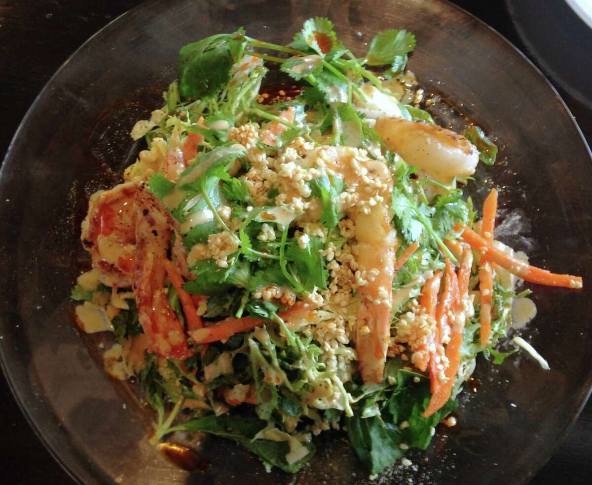 The Gulf Scrimp salad at O'liva features Texas shrimp, bok choy, Thai basil and bean sprouts in a soy ginger dressing.