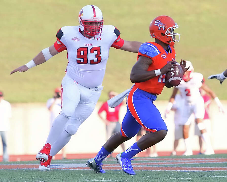 William Wowkanyn pressures the quarterback during the game between the Lamar Cardinals and the Sam Houston State Bearkats at Bowers Stadium in Huntsville, Saturday night, September 19th, 2015 - photo provided by Kyle Ezell