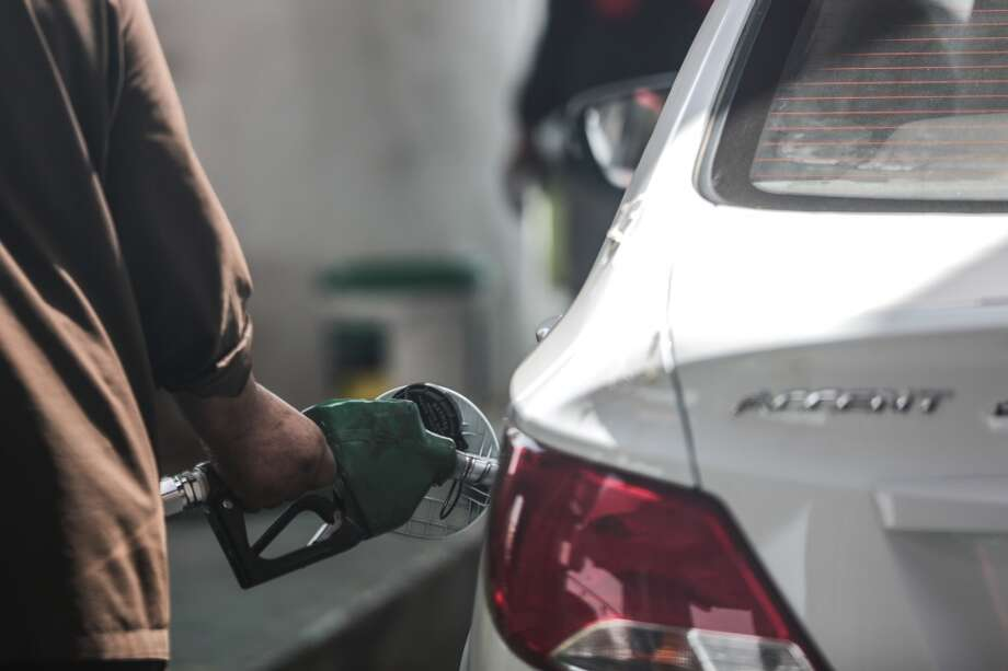 In this Wednesday, Sept. 16, 2015 photo, a car fills up at a gas station in Jiddah, Saudi Arabia. In Jiddah, drivers are fueling up their cars at just 45 cents a gallon, four times less than the price of water. (AP Photo/Mosa'ab Elshamy) Photo: Mosa'ab Elshamy, Associated Press