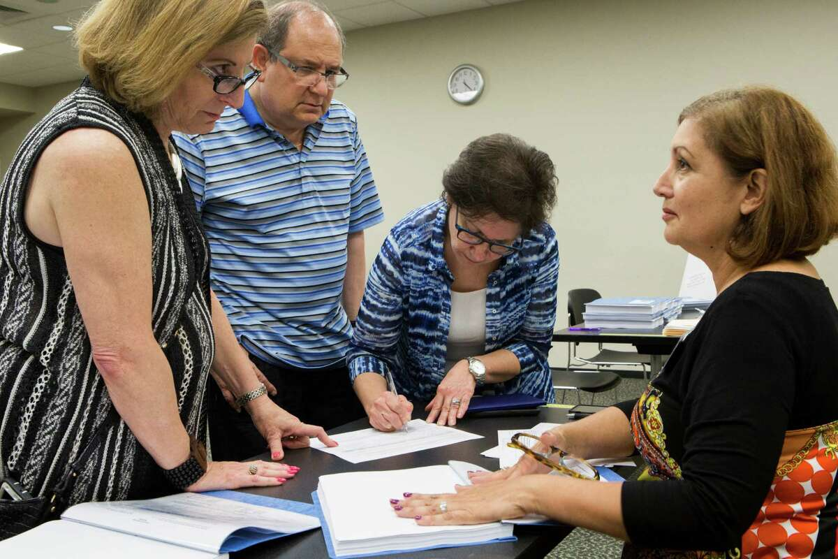 From left, Ann Magoon, Mal Lusky and Judy Lusky discuss last month a petition organized by Diana Miller, right, over a Sugar Land development code. ,