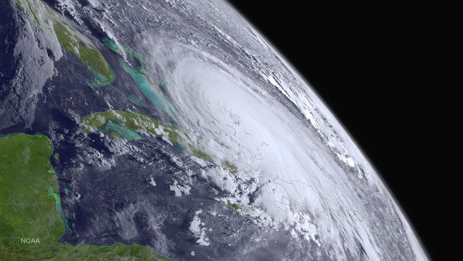 In this handout from the National Oceanic and Atmospheric Administration (NOAA), Hurricane Joaquin is seen churning in the Atlantic on October 1, 2015. Joaquin was upgraded to a category three hurricane early on October 1. The exact track has yet to be determined, but there is a  possibility of landfall in the U.S. anywhere from North Carolina to the Northeast. Photo: Handout, NOAA / 2015 NOAA