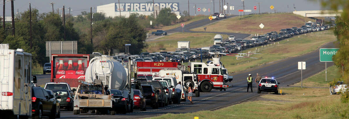 An Air Life helicopter lands Thursday October 1, 2015 on westbound highway 90 near Grosenbacher Road in west Bexar County after a man driving an SUV rolled his vehicle on Grosenbacher road shortly after 8:00 a.m.. Bexar County Sheriff's Office spokesman James Keith