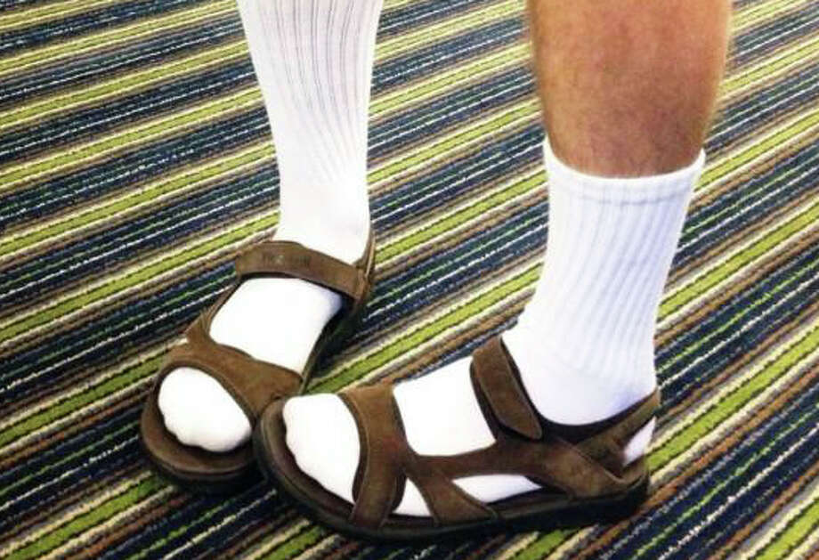 "On his newly discovered trend-setting style, columnist Thomas Lawlor writes: ""I have finally done it. It has taken me decades, but I am now hip ... My first inkling that I was ""too sexy for myself"" happened a few weeks ago. The Wall Street Journal had this headline: Wearing Socks with Sandals Is Fashionable: from football players to runway models, some don't toe traditional line."" Photo: Contributed / Contributed Photo / Fairfield Citizen"