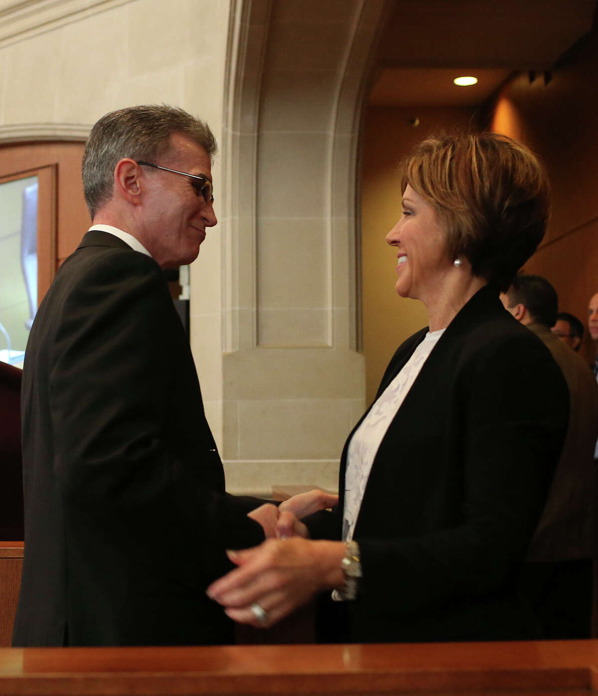 San Antonio City Manager Sheryl Sculley congratulated William McManus after he's nomination as the next San Antonio Police Department chief is unanimously approved by City Council, Thursday, Oct. 1, 2015. McManus quit the position to take the head of security at CPS Energy last year.