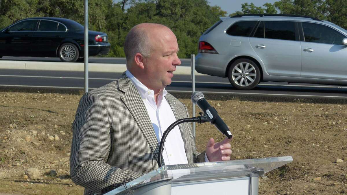 Precinct 3 Bexar County Commissioner Kevin Wolff marks completion of the county's $10 million road and drainage project on Boerne Stage Road, at a ribbon cutting event on Thursday Oct. 1 at the H-E-B at Interstate 10 West. The work widened the roadway and raised it out of flood danger.