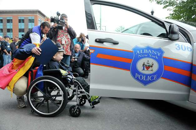 Evan Borggreen, 4, of Unadilla, looks at a Albany Police car outside of Albany Med on Thursday, Oct. 1, 2015, in Albany, N.Y.  Borggreen was sworn in as an honorary police officer in front of numerous members of the Albany Police force.  Borggreen is  battling acute lymphoblastic leukemia and is being treated at the Bernard & Millie Duker Children's Hospital at Albany Medical Center.  One of Borggreen's nurses, R.N. Ellen Scheer, knew that he wanted to be a police officer when he grows up and Borggreen has even made it a habit of going around to check in on other children in the hospital.  Scheer contacted Albany Police officer Christopher McCoy who talked to his command officers and city hall to make the event happen.  (Paul Buckowski / Times Union) Photo: PAUL BUCKOWSKI / 10033565A