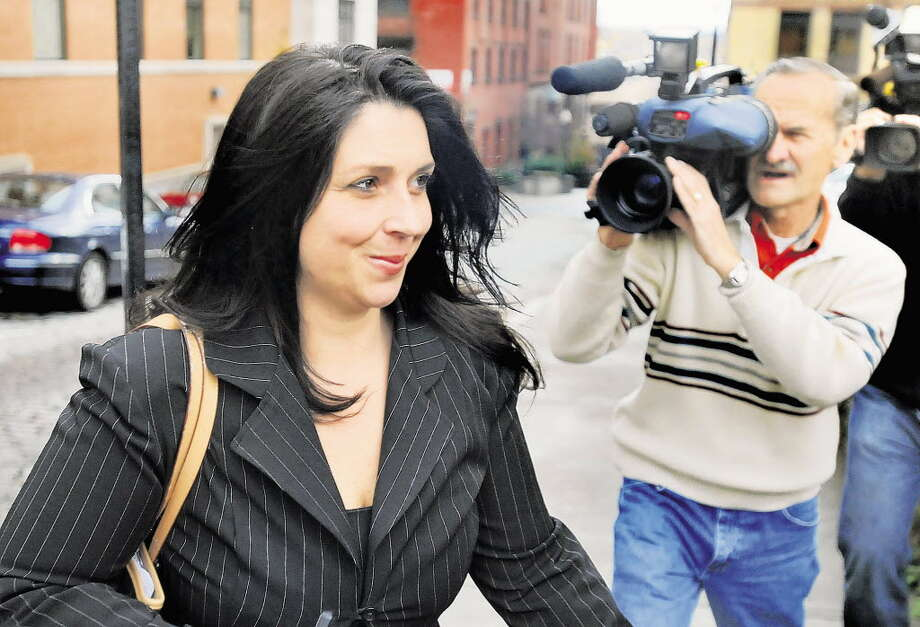 Angela Lopez leaves the Albany County Judicial Center on Wednesday, Nov. 17, 2010, in Albany, N.Y. Lopez is facing 12 felony counts based on her accumulating nearly $100,000 in a fraud scheme. (Cindy Schultz / Times Union)