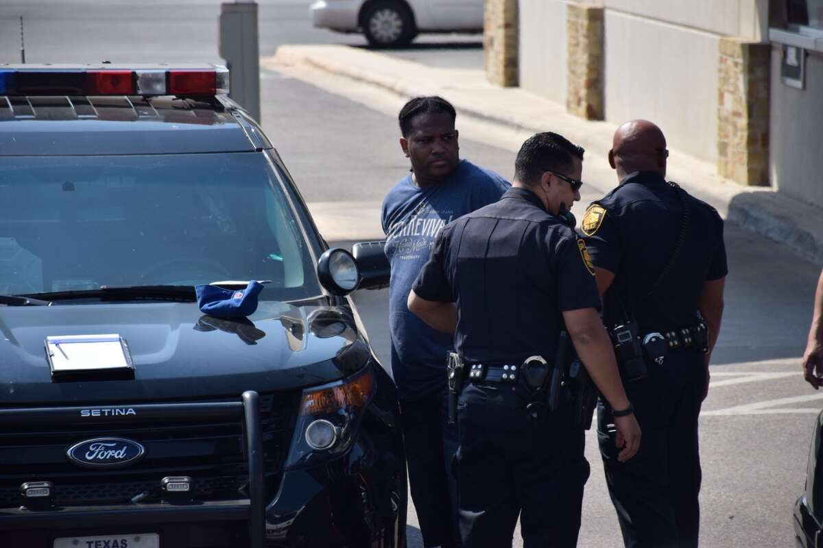 San Antonio police officers arrested three people suspected of being part of a robbery ring spanning multiple Texas cities at the Chase Bank in the Park North Shopping Center on Thursday, October 1, 2015.