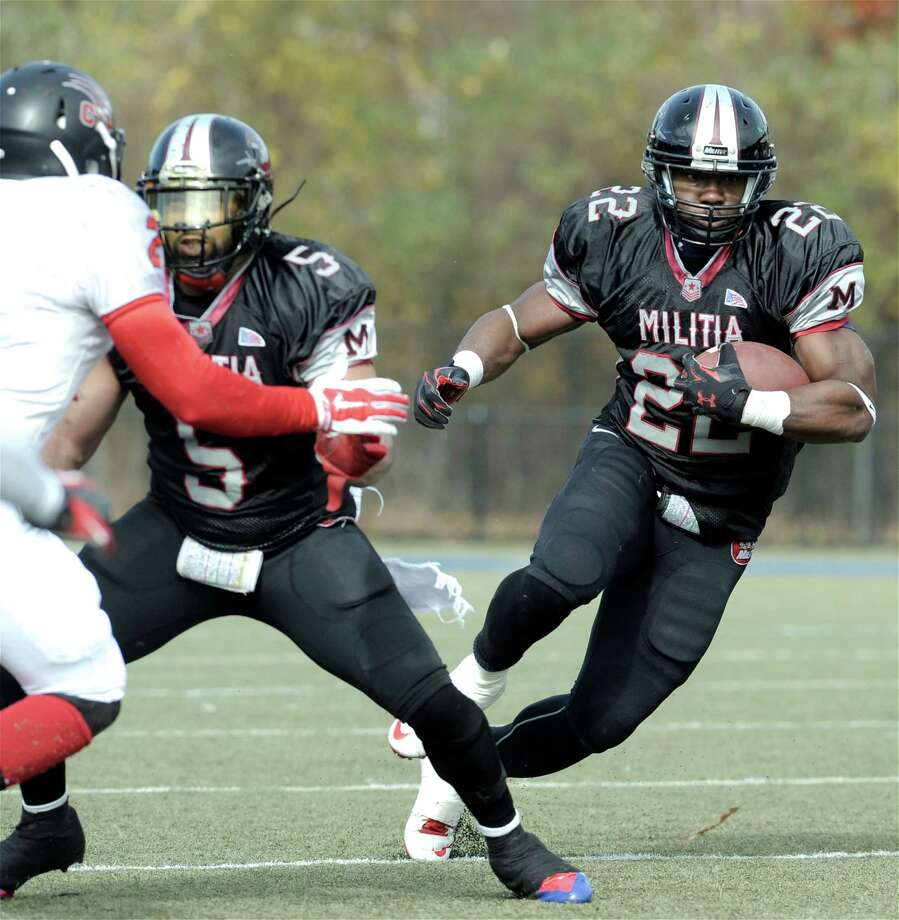 FILE PHOTO: The Militia's Lionel Assie (22) cuts off a block by team mate Jason Davis (5) on Panthers Courtney Sutherland (2) during the New England Football League AAA semifinals between the Western Connecticut Militia and the Connecticut Panthers, on Sunday, November 2, 2014, at Waterbury Municipal Stadium, Waterbury, Conn. Photo: H John Voorhees III / H John Voorhees III / The News-Times