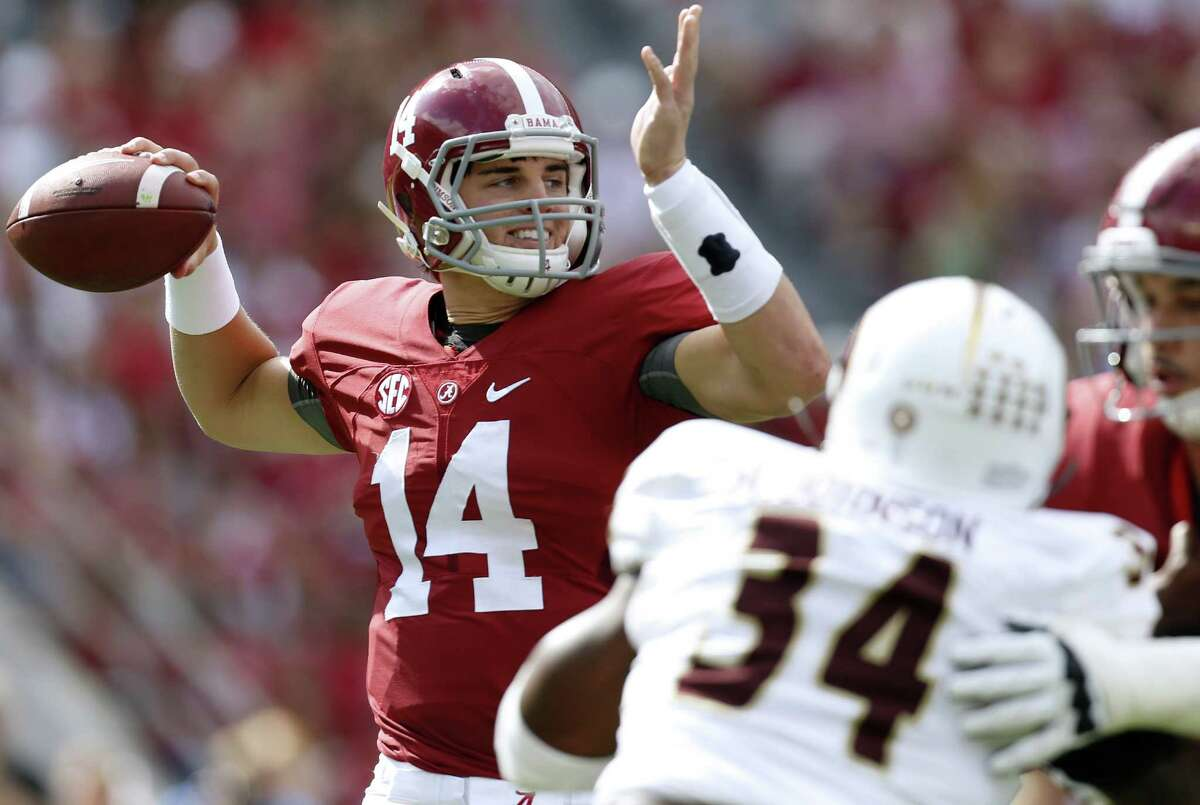 Alabama quarterback Jake Coker (14) throws a pass during the first half of an NCAA college football game against Louisiana Monroe in Tuscaloosa, Ala. In Athens, Georgia, the Bulldogs (4-0, 2-0) host No. 13 Alabama (3-1, 0-1), on Saturday, which looks to bounce back from a 43-37 home loss to Ole Miss nearly two weeks ago. It's the first meeting between the schools since the 2012 SEC title game won 32-28 by the Crimson Tide.
