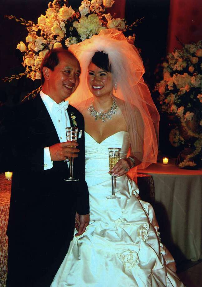 Katherine Le and her husband Hao Nguyen are pictured at their wedding.The pair were both arrested Thursday, Oct. 1, 2015, and charged with money laundering in connection with a Houston gameroom. Photo: Houston Chronicle / handout