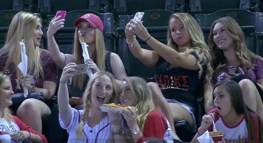 A group of girls have fun snapping selfies during a Diamondbacks-Rockies game Wednesday. Photo: MLB.tv