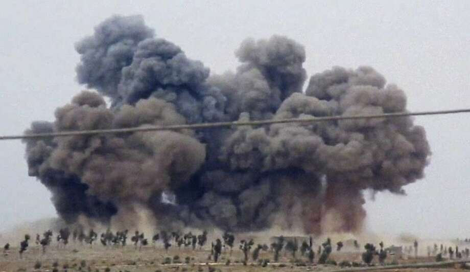 Smoke rises in Kafr Nabel in Idlib province after Russian jets carried out a second day of air strikes in Syria. President Vladimir Putin denies reports that civilians were killed. Photo: Hadi Al-Abdallah, Associated Press