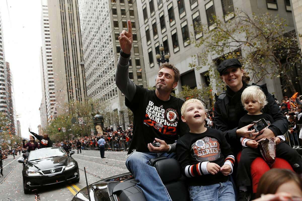Giants pitcher Jeremy Affeldt, wife Larissa and sons wave to fans during the World Series victory parade on Oct. 31, 2012.
