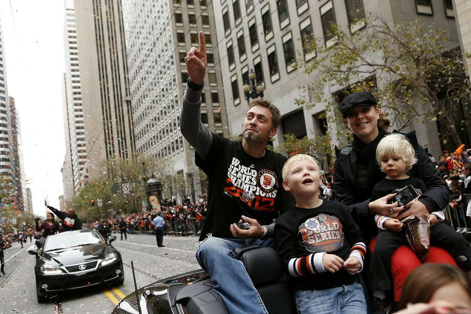 Giants pitcher Jeremy Affeldt, wife Larissa and sons wave to fans during the World Series victory parade on Oct. 31, 2012. Photo: Beck Diefenbach, Special To The Chronicle