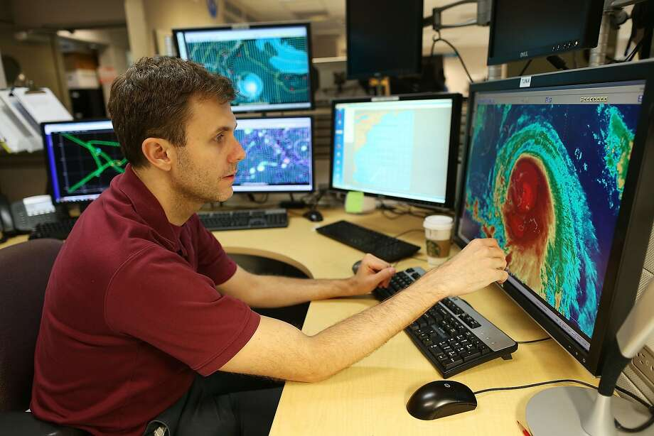 Eric Blake, a hurricane specialist, uses a computer at the National Hurricane Center in Miami to track the path of Hurricane Joaquin, as it passes over parts of the Bahamas. Photo: Joe Raedle, Getty Images