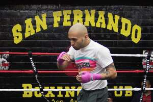 Boxer James Leija, Jr. practices in the ring during a media event in 2015 at San Fernando Boxing Club in San Antonio.