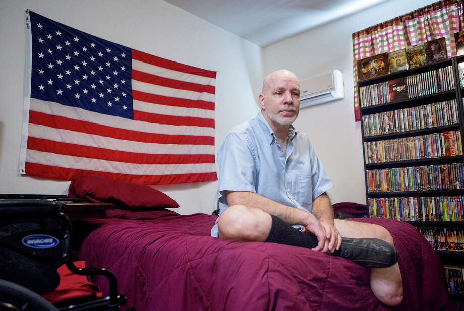Jeffrey Alan Taylor sits on his bed at his apartment complex in the 4500 block of Travis Street, Monday, Sept. 21, 2015, in Houston. Taylor had a foot amputated at a Houston hospital due to complications from diabetes. When he left the hospital, he applied for housing at Cloudbreak Communities, requiring a background check. However, the company performing that check wrongly confused him with someone with the same name who was a convicted sex offender. Photo: Cody Duty, Houston Chronicle / © 2015 Houston Chronicle