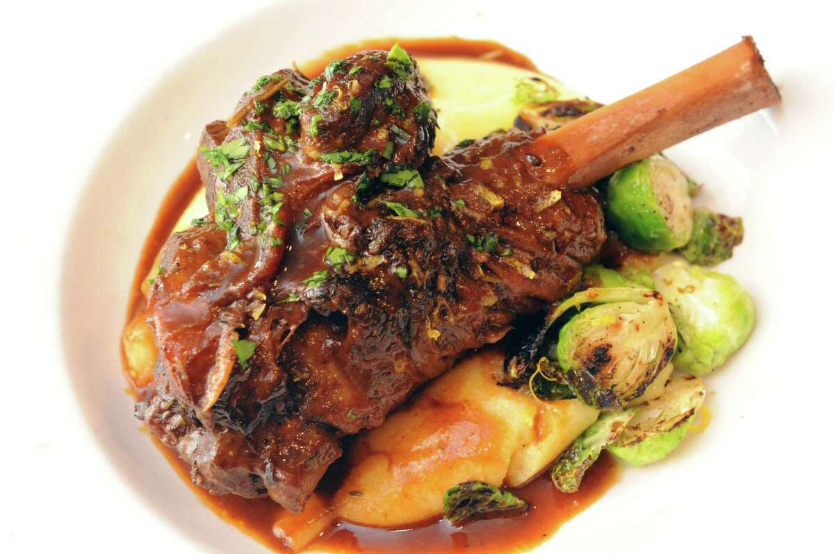 Braised lamb shank with polenta and Brussels sprouts at Cella Bistro on Friday, Sept. 25, 2015, in Schenectady, N.Y. (Michael P. Farrell/Times Union)