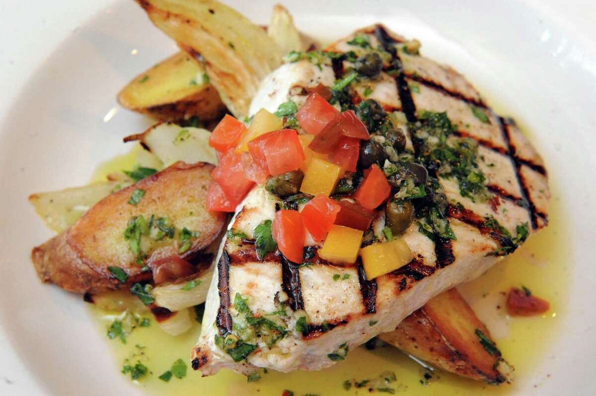 Grilled swordfish with roasted fennel, potatoes,onions and Sicilian salsa verde and heirloom tomatoes at Cella Bistro on Friday, Sept. 25, 2015, in Schenectady, N.Y. (Michael P. Farrell/Times Union)