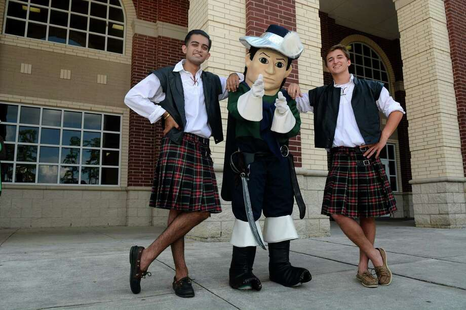 "The Woodlands Highlanders senior mascots Omar Saber, left, and Turner Routh, right, join College Park Cavaliers junior mascot Shelby Hines, dressed as ""Calvin the Cavalier"" at The Woodlands College Park High School. Photo: Jerry Baker, Freelance"