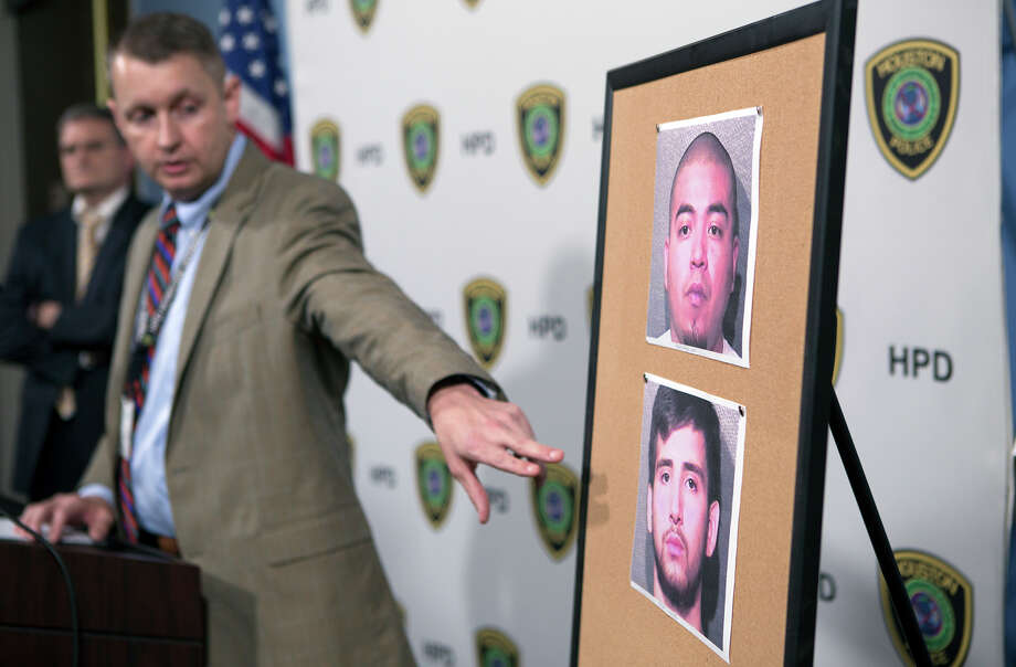 Homicide investigator Travis Miller points to photos of Alexis Cuapio, top, and Oscar Ollervides, bottom, during a news conference at the Edward A. Thomas Building, Thursday, Oct. 1, 2015, in Houston. The two have suspects have been arrested in connection with the fatal shooting of a 6-year-old boy at 6622 Narcissus last Friday. Photo: Cody Duty, Houston Chronicle / © 2015 Houston Chronicle