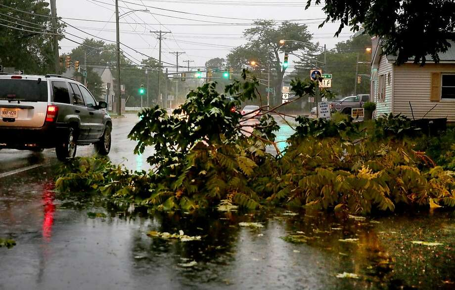 Tree limbs block a portion of a road due to severe weather in Northfield, N.J. Tornado warnings were issued in several states and at least four governors declared states of emergency. Photo: Vernon Ogrodnek, Associated Press