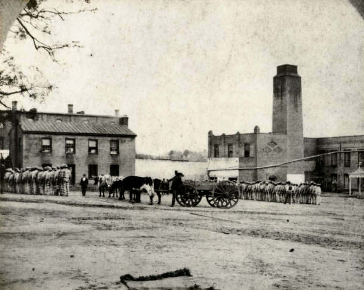 This photo shows the Huntsville Unit prison yard in the 1870s. (Creative Commons: Wikimedia)