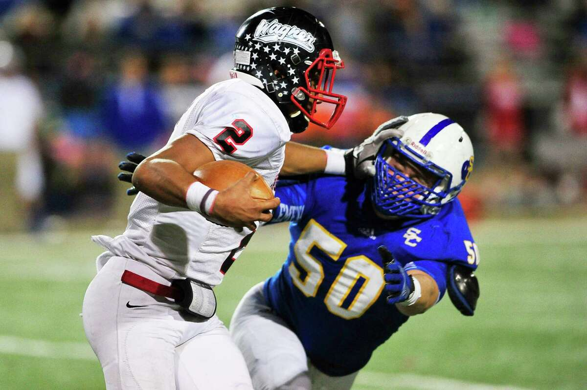 Wagner's Jordan Batson stiff-arms Clemens' Tristen Blake, right, during Samuel Clemens game against Wagner at Clemens in San Antonio on Friday, Oct. 31, 2014.
