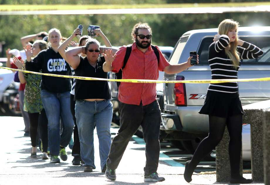 Students, staff and faculty are evacuated from Umpqua Community College in Roseburg, Ore. after a deadly shooting Thursday, Oct. 1, 2015.  Photo: Michael Sullivan, AP / The News-Review