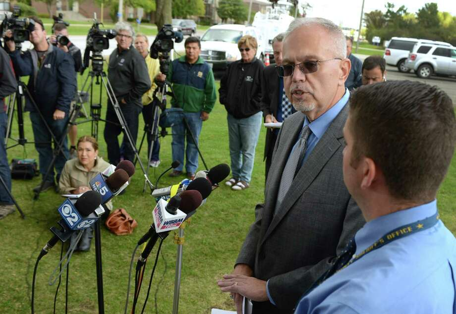 Lake County Major Crimes Task Force Cmdr. George Filenko and Lake County Sheriff's Det. Christopher Covelli, right, answer reporter's questions during a press conference giving an update on the investigation into the death of Fox Lake Police Lt. Joe Gliniewicz Thursday, Oct. 1, 2015 in Fox Lake, Ill. Filenko said that Gliniewicz was shot with his own weapon.  (Paul Valade/Daily Herald via AP)  MANDATORY CREDIT, MAGS OUT Photo: Paul Valade, MBI / Daily Herald