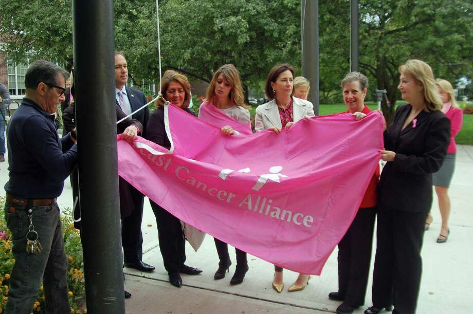 With some help from Town Hall, from left, Breast Cancer Alliance President Sharon Phillips, First Selectman Peter Tesei,  BCA Executive Director Yonni Wattenmaker, Loren Taufield, chairman of BCAís Go For Pink Committee, Kathy Carly-Spanier and Jan Larkin, both whom represented Greenwich Hospital, raised the BCA flag where it will remain for October. Photo: Ken Borsuk / Hearst Connecticut Media / Greenwich Time