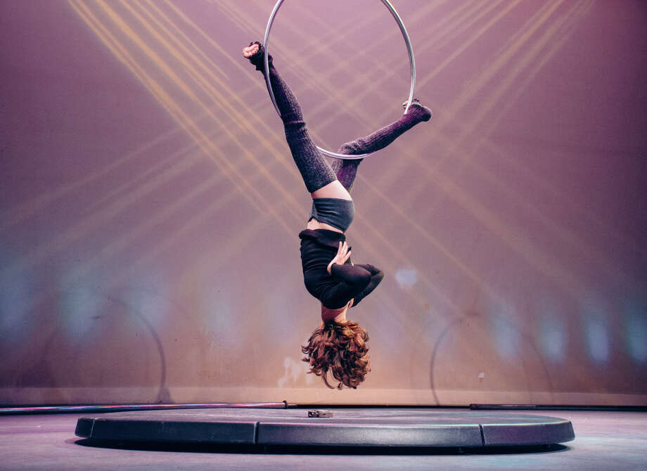 The fitness and artistry of aerial hoop dancing is demonstrated here. Fitness and artistry will be highlighted when the annual pole fitness showcase takes place at The Ridgefield Playhouse on Friday, Oct. 16. Photo: Anne Waupotic / Contributed Photo / 2014