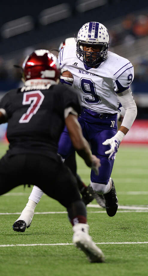 Newton's Gabe Foster, No. 9, advances the ball against Waskom during Thursday's championship game. The Newton Eagles played against the Waskom Wildcats at the AT&T Stadium in Arlington, TX, for the 3A Division II championship on Thursday afternoon. Photo taken Thursday 12/18/14 Jake Daniels/The Enterprise   Manditory Credit, No Sales, Mags Out, TV OUT, Web: AP Members Only Photo: Jake Daniels / ©2014 The Beaumont Enterprise/Jake Daniels
