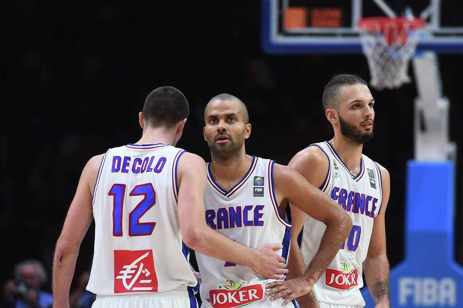 (From left) France guard Nando De Colo, point guard Tony Parker and shooting guard Evan Fournier react during the third place game against Serbia at the EuroBasket 2015 in Lille, France, on Sept. 20, 2015. Photo: Emmanuel Dunand /Getty Images / AFP
