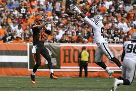 Cleveland Browns Josh McCown throws under pressure from Oakland Raiders Aldon Smith during an NFL football game Sunday, Sept. 27, 2015, in Cleveland. Oakland won 27-20.(AP Photo/Aaron Josefczyk)