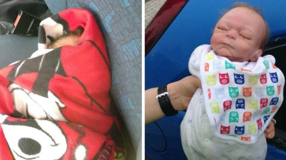 Police officers broke into a car parked at a hospital in Dudley, England, to rescue what they thought was an ailing infant. The baby, whose face was partially obscured by a blanket (left), turned out to be a doll. Photo: West Midlands Police