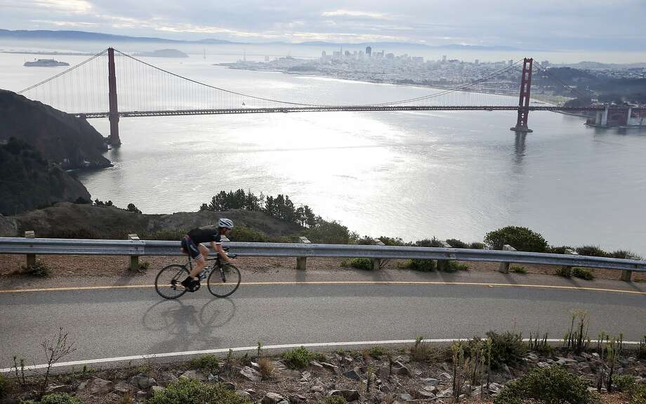 A bicyclist cruises past a picturesque view of the Golden Gate Bridge and San Francisco in the Marin Headlands on Thursday, Oct. 1, 2015. Photo: Paul Chinn, The Chronicle