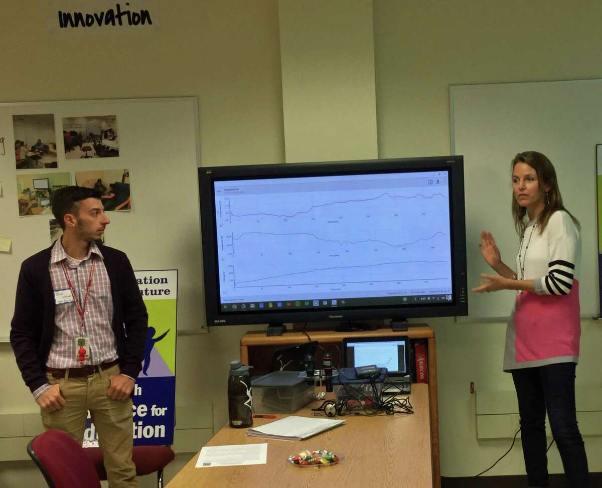 Brian Walach and Sarah Goldin, STEM teachers in the Greenwich High School Innovation Lab, show a STEM assignment that students do with their Chromebook laptops.