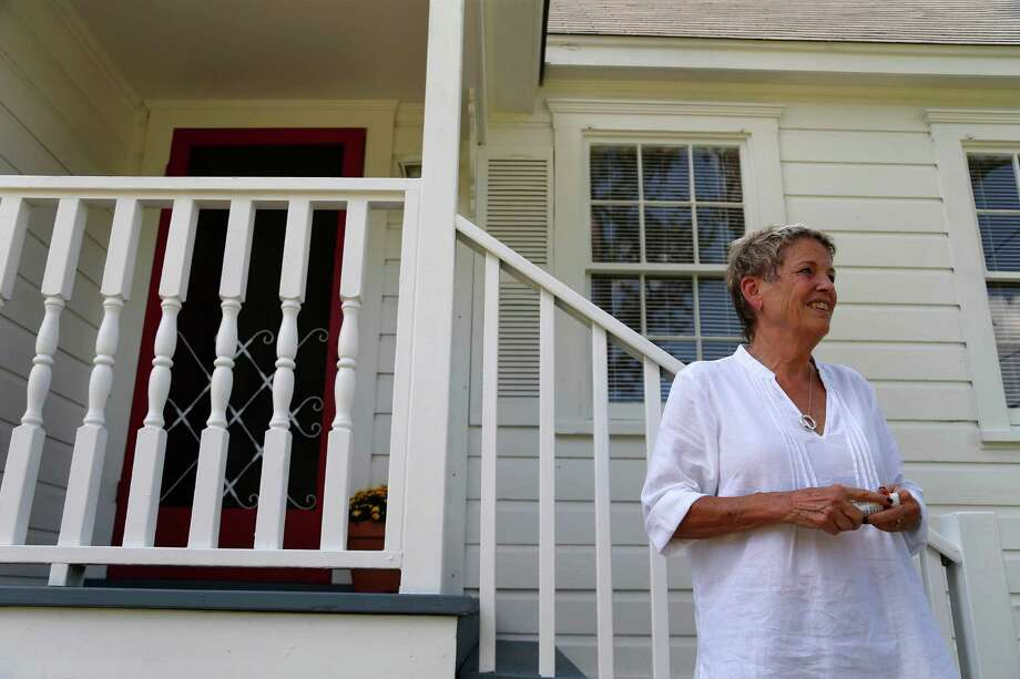 """Heidi Eagleton had this bungalow moved from the northern Heights to Acres Homes, where she is creating a """"pocket neighborhood."""" The house will be a community center. Photo: Karen Warren, Staff / © 2015 Houston Chronicle"""