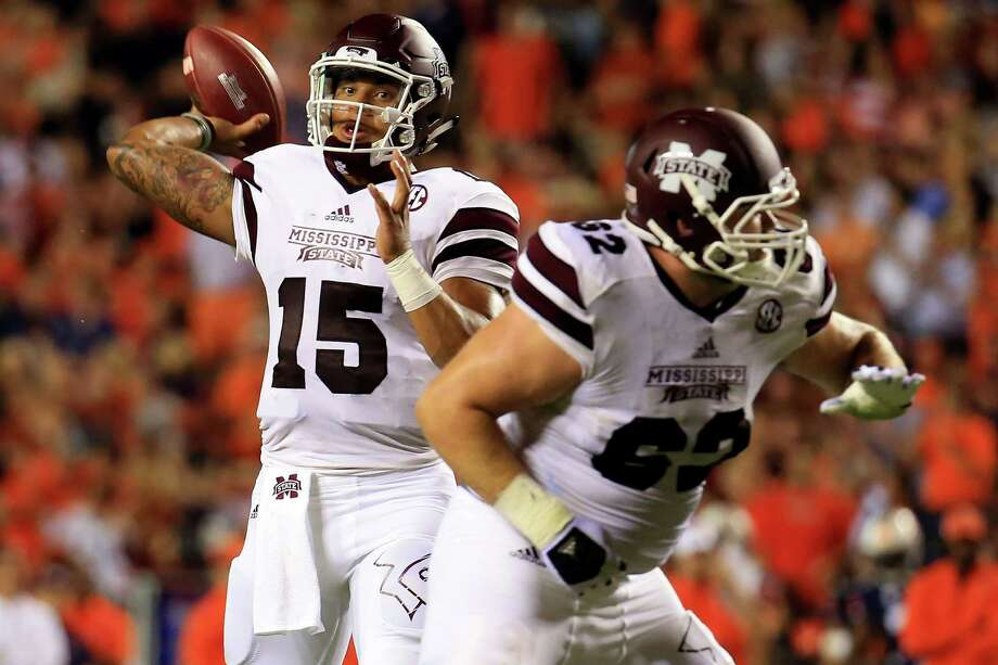 Mississippi State quarterback Dak Prescott had 356 yards of total offense and five touchdowns in the Bulldogs' 48-31 victory over Texas A&M this past season. Photo: Daniel Shirey, Stringer / 2015 Getty Images