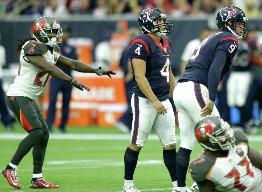 "Tampa Bay Buccaneers defensive back Tim Jennings (28) signals ""no good"" as Houston Texans kicker Randy Bullock (4) and holder Shane Lechler watch a missed kick during the second quarter of their game at NRG Stadium. Photo: Brett Coomer, Staff / © 2015  Houston Chronicle"