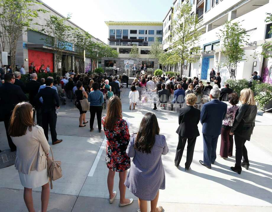 The River Oaks District's opening drew a crowd on Thursday. About two dozen retailers opened their doors, with more to follow. Photo: Karen Warren, Staff / © 2015 Houston Chronicle