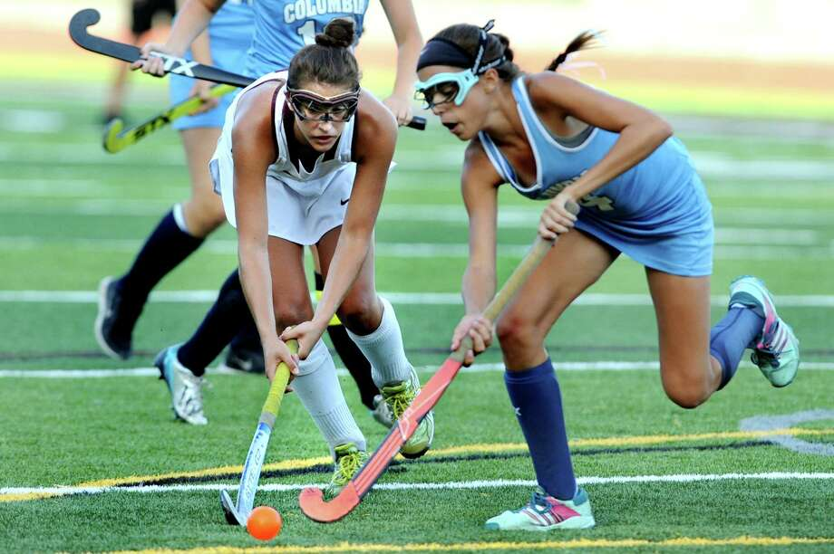 Burnt Hills' Elise Zwicklbauer, left, battles Columbia's Renee Smith for the ball during their field hockey game on Friday, Sept. 25, 2015, at Burnt Hills High in Burnt Hills, N.Y. (Cindy Schultz / Times Union) Photo: Cindy Schultz / 10033488A